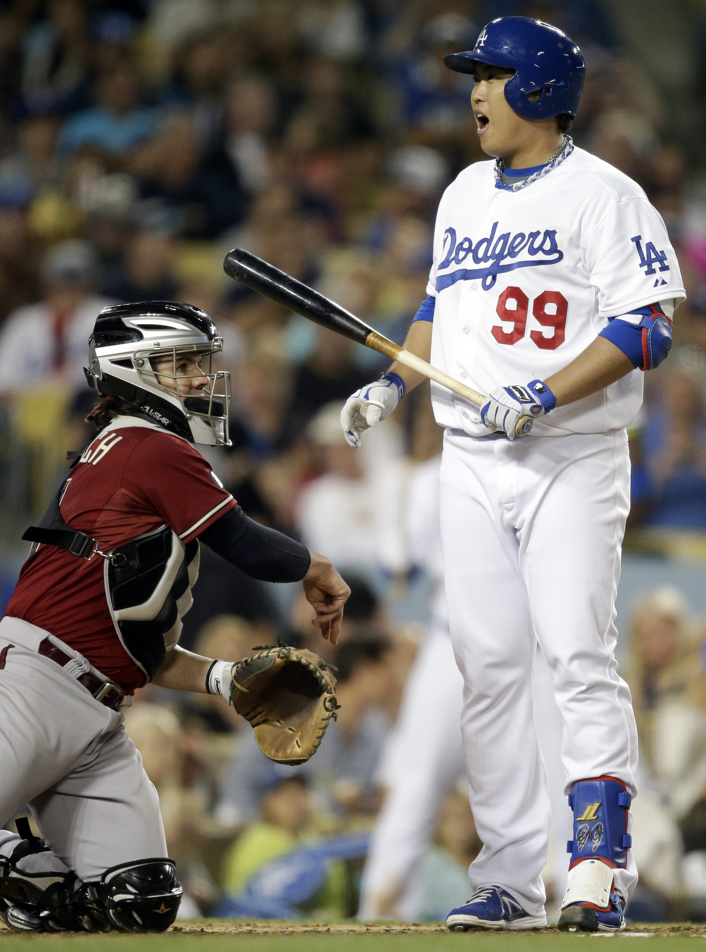 Los Angeles Dodgers' Hyun-jin Ryu (99), of South Korea, reacts to a strike call by the umpire while batting against the Arizona Diamondbacks during the second inning of a baseball game on Wednesday, Sept. 11, 2013, in Los Angeles. (AP Photo/Jae C. Hong)