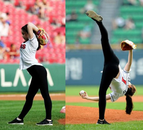 Shin Soo-ji rotates 360 degrees during her ceremonial first pitch in this file photo.