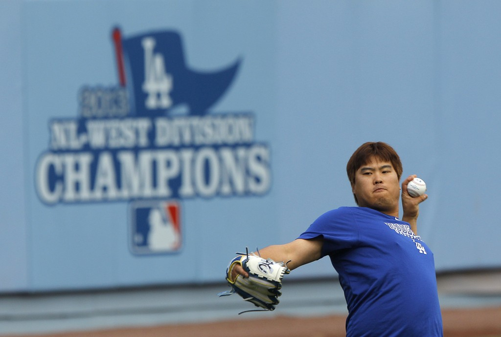 Los Angeles Dodgers starting pitcher Hyun-Jin Ryu, of South Korea, throws the ball during practice in preparation for Monday's Game 3 of the National League baseball championship series against the St. Louis Cardinals, on Sunday, Oct. 13, 2013, in Los Angeles. (AP Photo/Jae C. Hong)