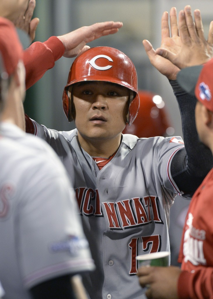 Cincinnati Reds' Shin-Soo Choo (17) is greeted by teammates in the dugout after scoring in the fourth inning of the NL wild-card playoff baseball game against the Pittsburgh Pirates on Tuesday, Oct. 1, 2013, in Pittsburgh. (AP Photo/Don Wright)