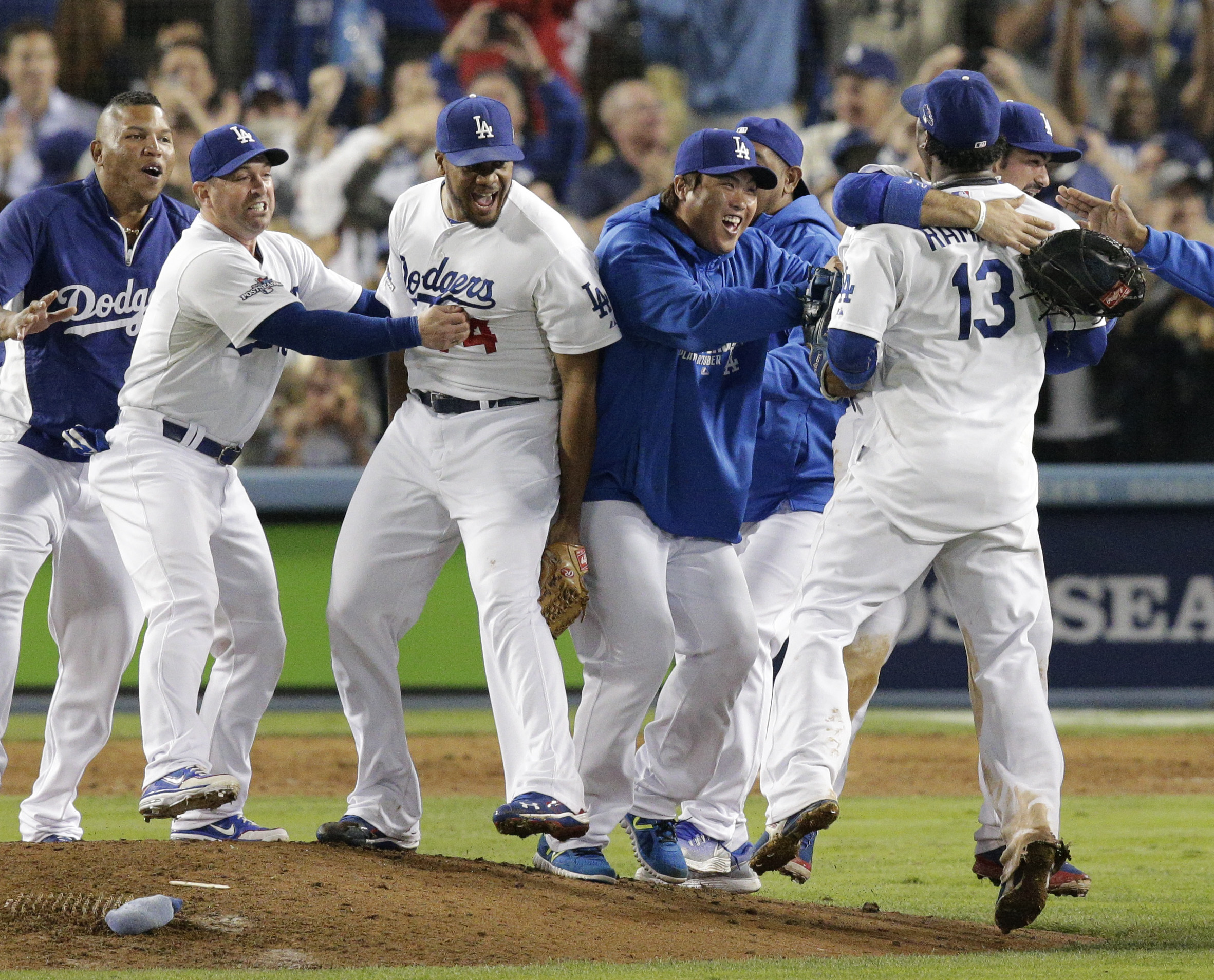 Los Angeles Dodgers pitcher Hyun-Jin Ryu,center right,  of South Korea, joins teammates in celebrating the Dodgers' 4-3 win over the Atlanta Braves in Game 4 of the National League baseball division series Monday, Oct. 7, 2013, in Los Angeles. The Dodgers advanced to the NL championship series. (AP Photo/Jae C. Hong)