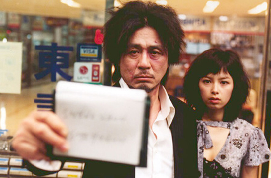 "Choi Min-sik,left, and Kang Hye-jung star in the movie ""Old Boy"" by director Park Chan-wook. The film won the Grand Prix Prize in 2004 at the Cannes Film Festival. / Korea Times file"