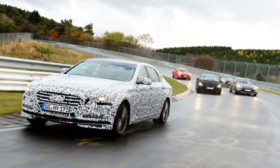 """The fully-revamped Genesis sedan, on the front, is on the Nurburgring test circuit called """"Green Hell"""" in Rheinland-Pfalz, midwest of Germany. / Courtesy of Hyundai Motor"""