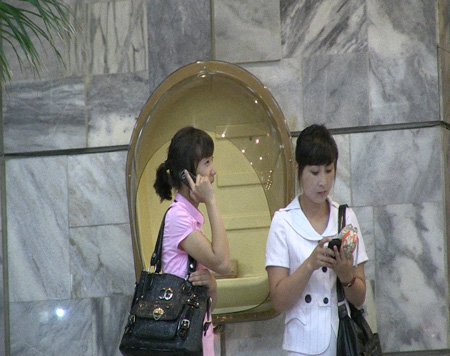 North Korean women use their smartphones in Pyongyang, North Korea, in August.  /  Courtesy of Medical Aid for Children