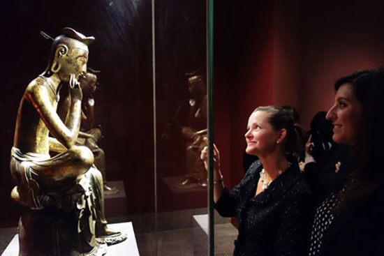 "The Maitreya in Meditation, a 7th-century gilt-bronze Buddhist statue designated as National Treasure No. 83, is on display at the ""Silla: Korea's Golden Kingdom"" exhibition at the Metropolitan Museum of Art (Met) in New York, the United States. The exhibition will continue through Feb. 23, 2014, featuring a total of 132 objects from the Silla Kingdom.  / Courtesy of National Museum of Korea"