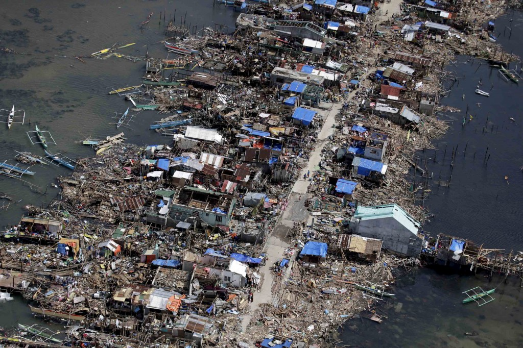 An aerial image taken from a Philippine Air Force helicopter shows the devastation of the first landfall by typhoon Haiyan in Guiuan, Eastern Samar province, central Philippines Monday, Nov. 11, 2013. Authorities said at least 2 million people in 41 provinces had been affected by Friday's typhoon Haiyan and at least 23,000 houses had been damaged or destroyed. (AP Photo/Bullit Marquez)