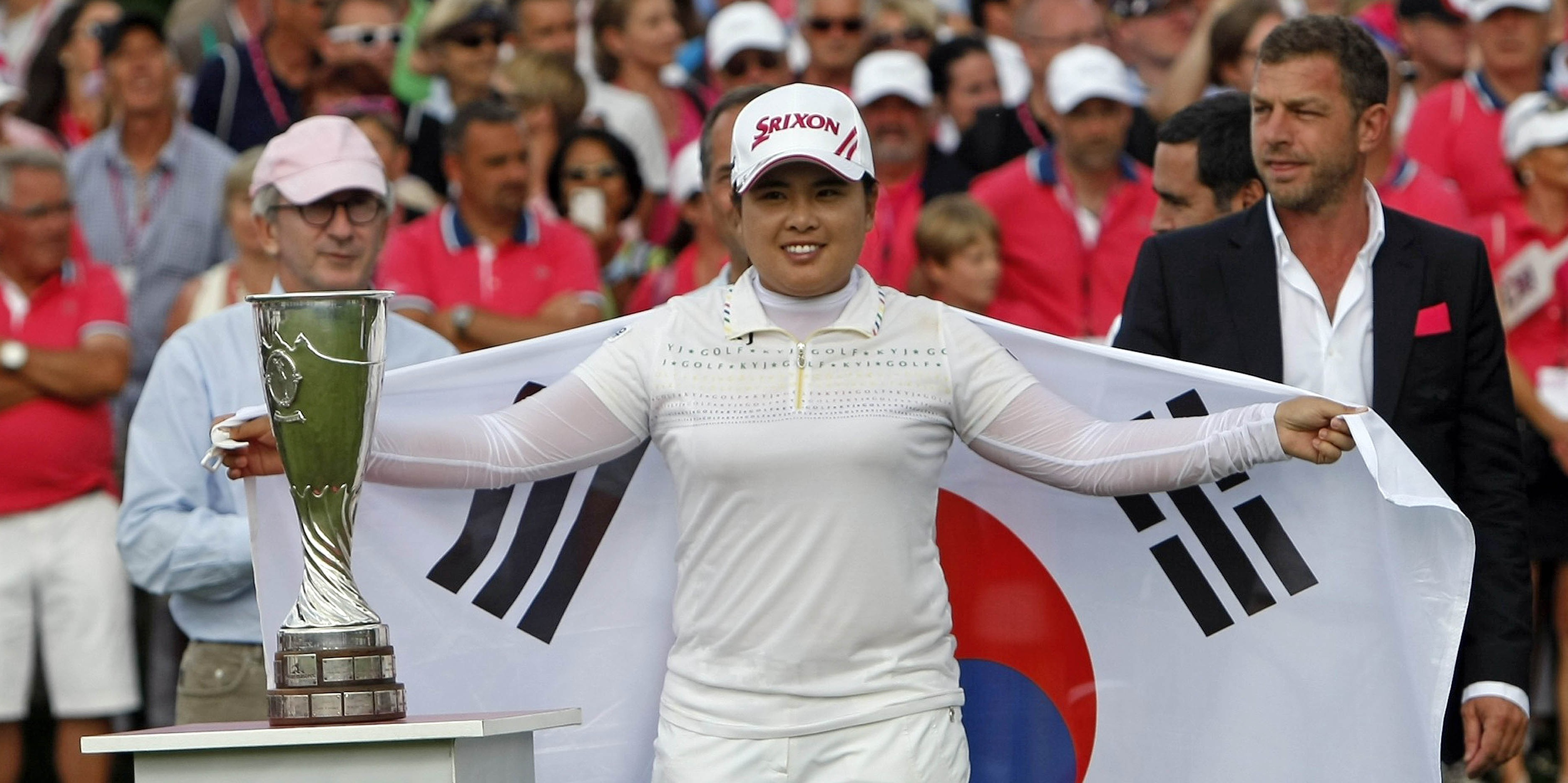 South Korea's Park In-bee holds the South Korean flag as she poses with the trophy after winning the Evian Masters women's golf tournament in Evian, France, Sunday, July 29, 2012.(AP Photo/Claude Paris)