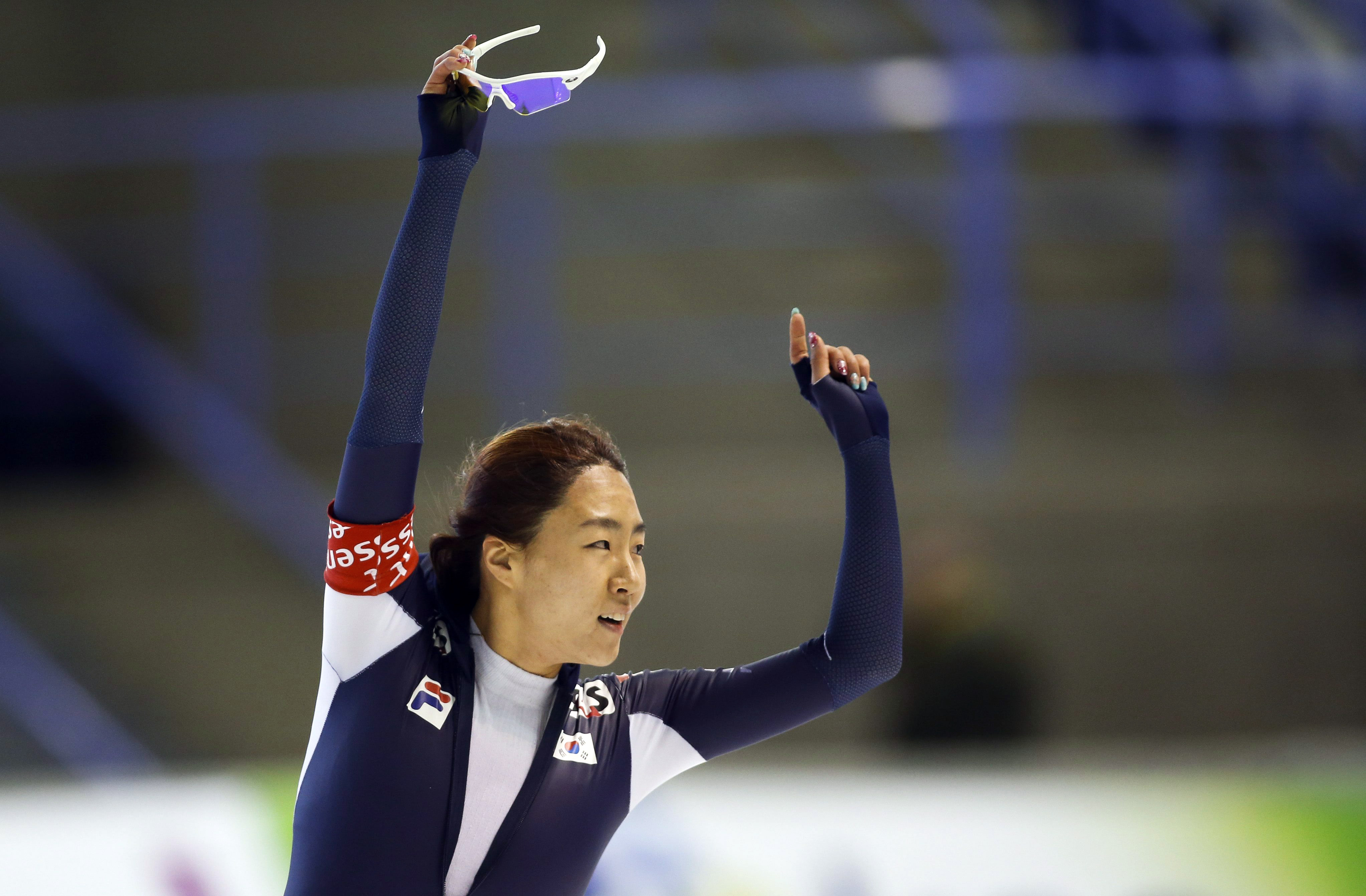 South Korea's Lee Sang-hwa celebrates her new world record during the ladies 500-meter competition at the World Cup speedskating event in Calgary, Alberta, Saturday, Nov. 9, 2013. Lee's time of 36.74 seconds at the Olympic Oval in Calgary erased the previous mark of 36.80 she'd set in Calgary on Jan. 20. (AP Photo/The Canadian Press, Jeff McIntosh)