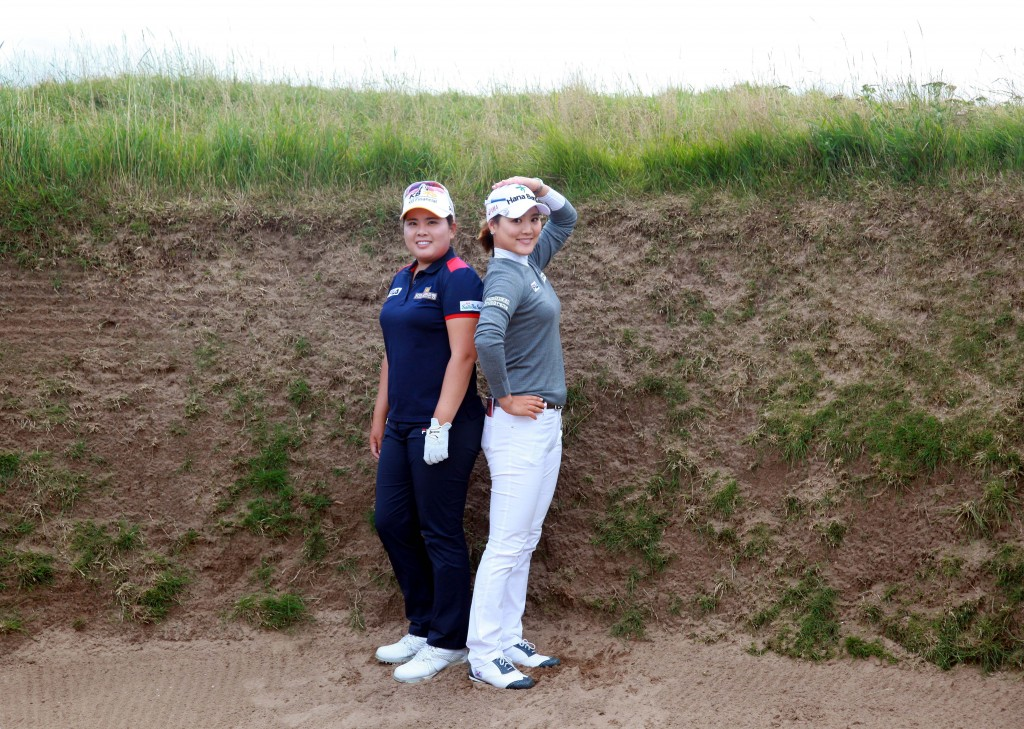 Park Inbee, left, and Ryu So Yeon, posed inside a bunker at British Women's Open. They finished 1-2 among Koreans on the money list this year. (Yonhap)