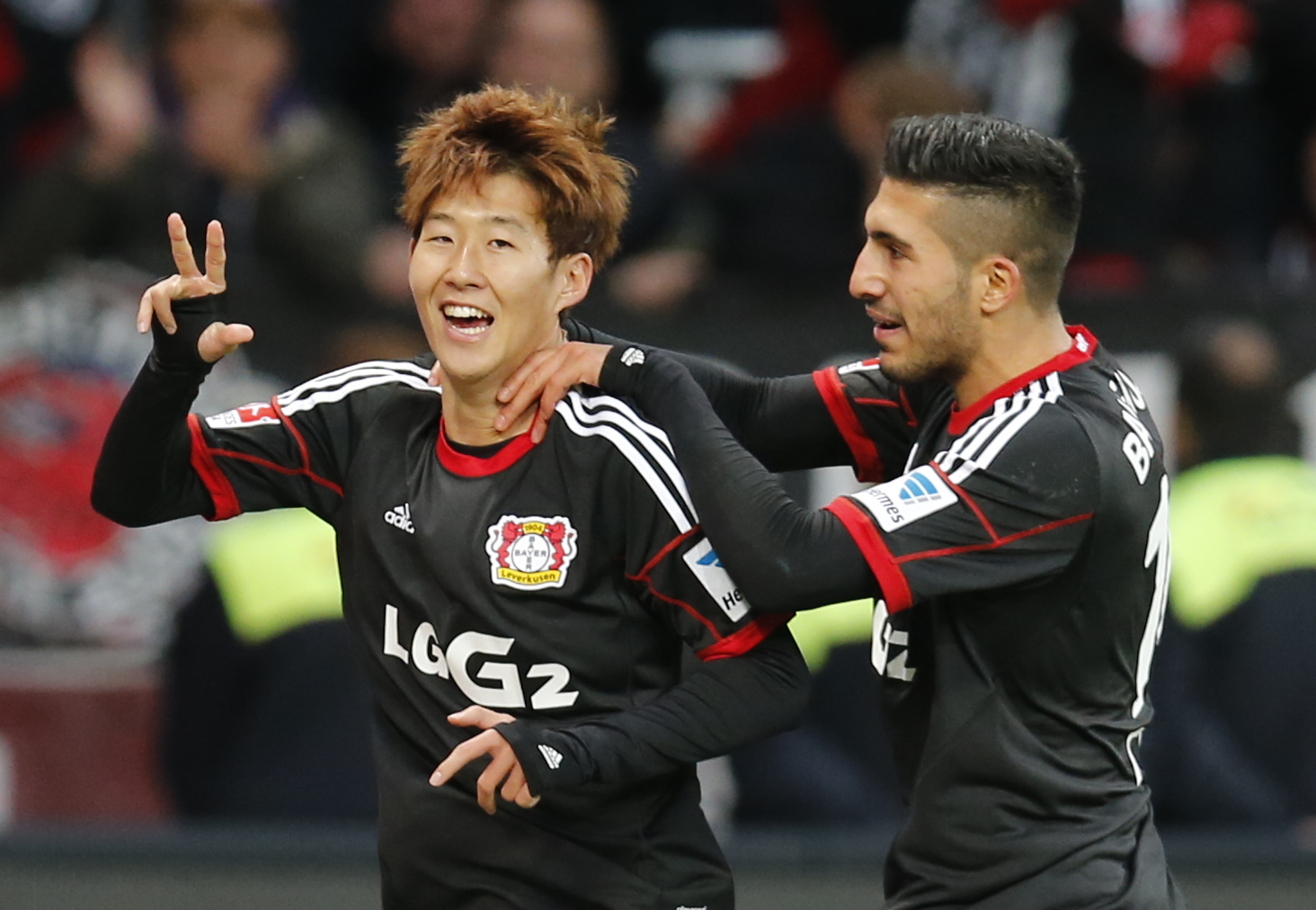 Leverkusen's Son Heung-min  of South Korea, left, and Leverkusen's Emre Can celebrate after scoring during the German first division Bundesliga soccer match between Bayer Leverkusen and Hamburger  SV in Leverkusen, Germany, Saturday, Nov. 9, 2013. (AP Photo/Frank Augstein