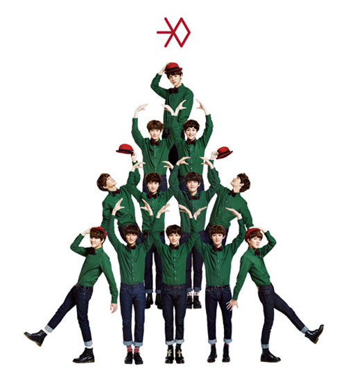 EXO members form a Christmas tree in this promotional photo