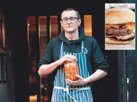 Kimchi Cult's Danny O'Sullivan poses with a jar of his homemade kimchi. Inset photo shows Kimchi Cult's kimchi cheeseburger.  / Provided by Kimchi Cult