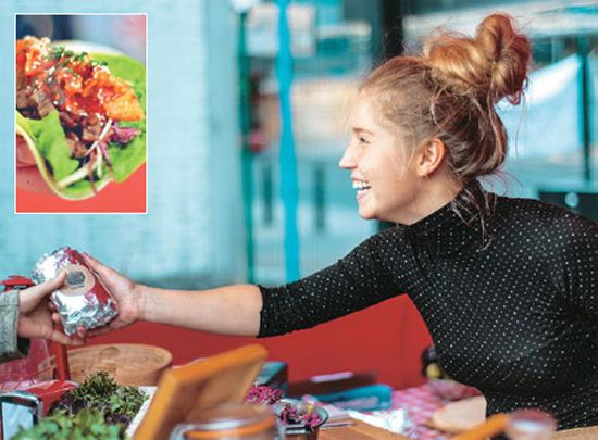 Hanna Soderlund greets customers in her Kimchinary food stall near King's Cross Station this summer. Inset photo shows her kimchi burrito. / Provided by Kimchinary