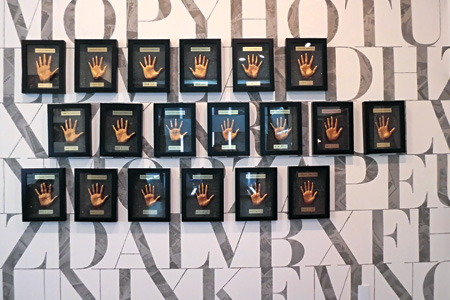 The handprints of K-pop idols including those of boy-band EXO grace the wall of the center.