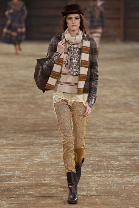 A model walks on a runway wearing pants made from TROA's hanji fabric during Chanel's Pre-Fall 2014 fashion show in Dallas, Texas on Dec. 10. (Courtesy of Evans Caglage/Firstview.com)