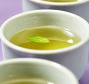 Green tea has caffeine as well as other healthy attributes that cannot be found in coffee.