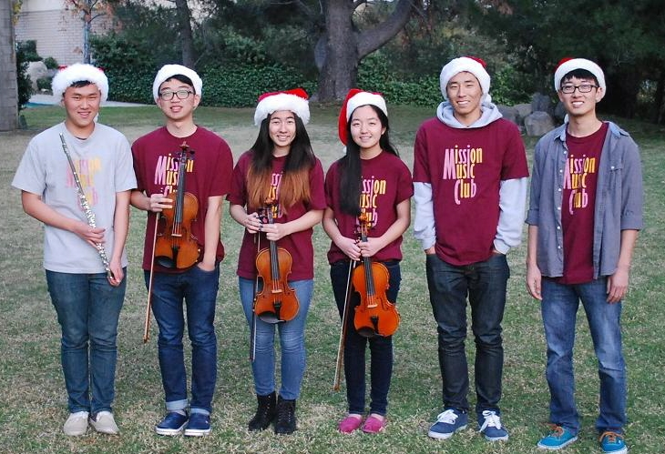 Robert Lee, second from left, and the Mission Music Club members are making senior citizens happy this holiday season.
