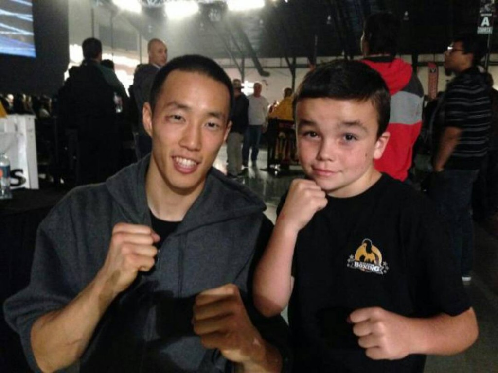 Daniel Kim poses with a young fan after posting his first professional win. (Photo - courtesy of Alan Kemp)