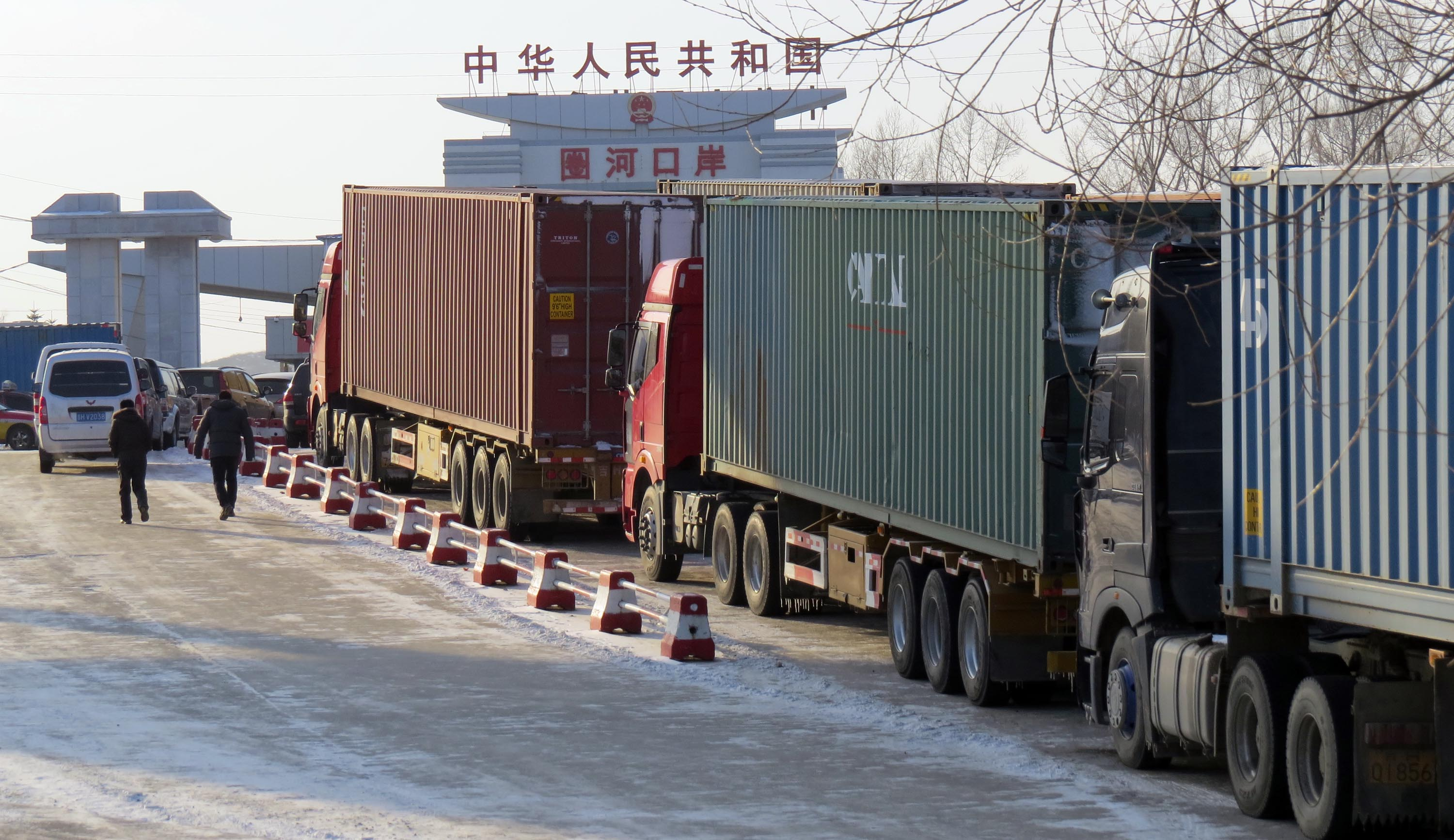 Chinese shipping container trucks are waiting to enter North Korea. (Yonhap)