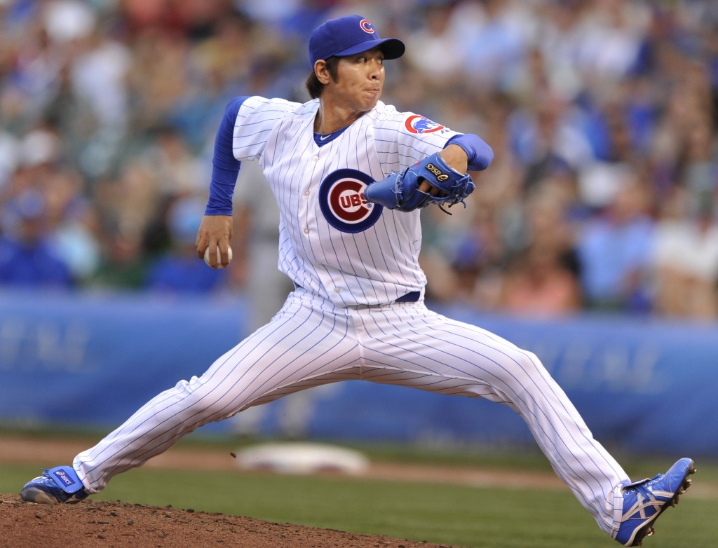 Chicago Cubs relief pitcher Chang-Yong Lim delivers a pitch during the seventh inning of a baseball game against the Milwaukee Brewers in Chicago, Saturday, Sept. 7, 2013. (AP Photo/Paul Beaty)