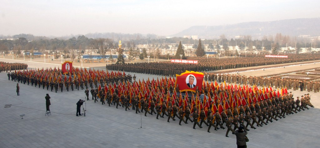 A military parade is under way at the plaza of the Kumsusan Palace of the Sun in Pyongyang on Dec. 16, 2013 to commemorate the second anniversary of the death of late North Korean leader Kim Jong-il. The North Korean soldiers said they are ready to die to defend leader Kim Jong-un. (KCNA-Yonhap)