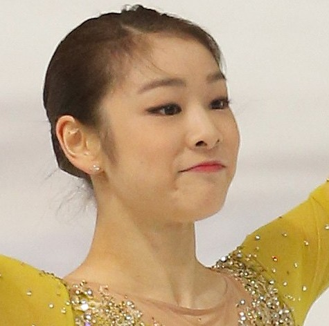 South Korea's Kim Yu-Na salutes the audience after performing in the short program of Golden Spin figure skating competition in Zagreb, Croatia, Friday, Dec. 6, 2013. (AP Photo/Darko Bandic)