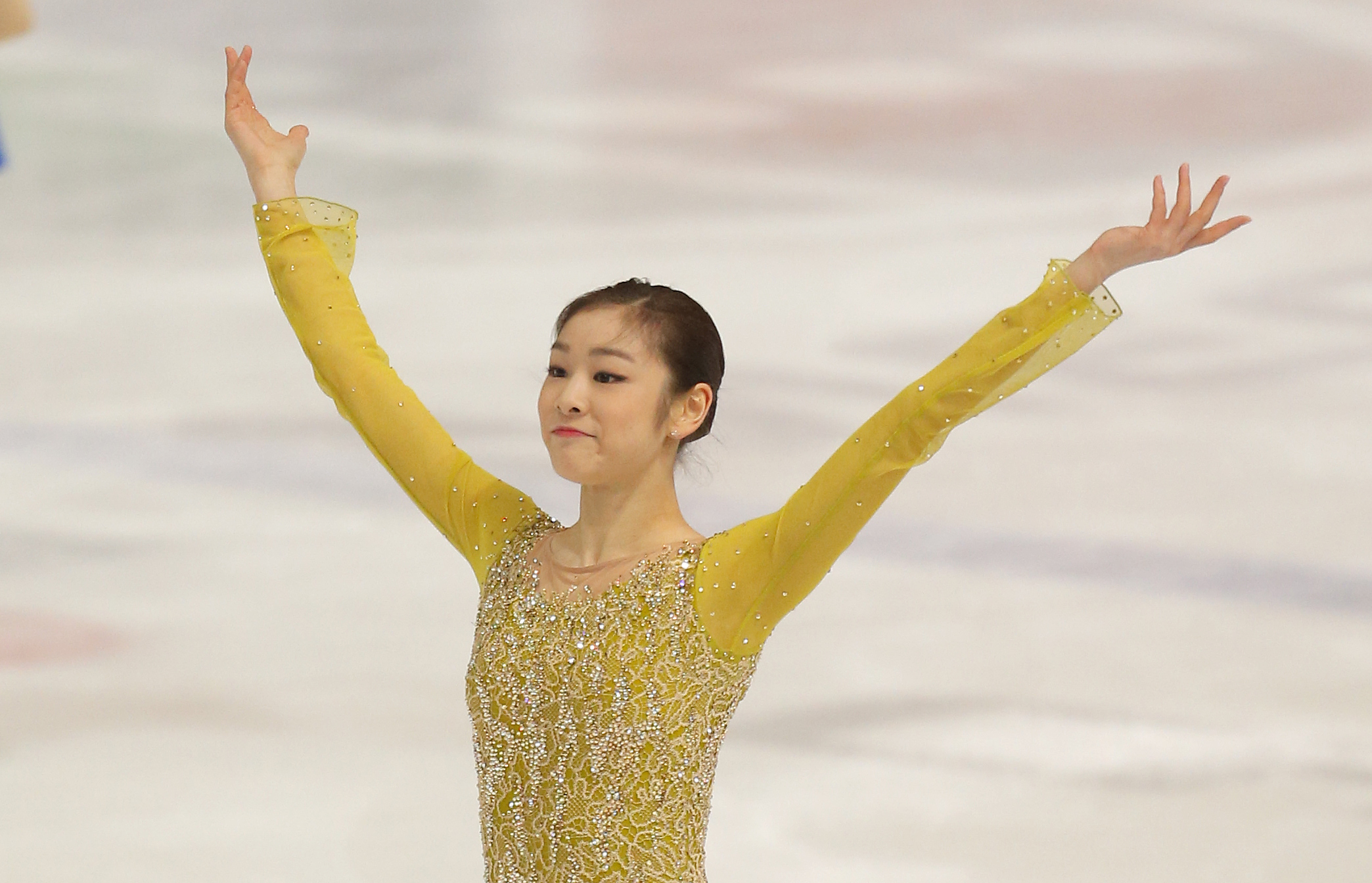 Kim Yu-Na takes a bow after a recent competition in Croatia. Photo by AP.