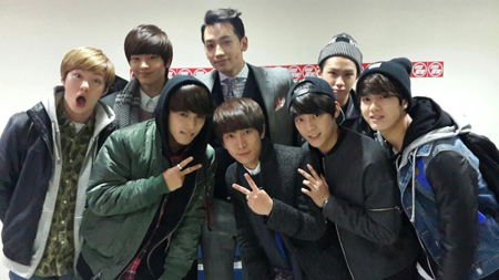 BTOB members pose with Rain, center in the back row in this file photo.