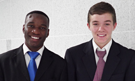 Boris Ondo, left, from Gabon, and Evan Trotzuk, from the United States, are working as interns for Rep. Jasmine Lee. (Korea Times)