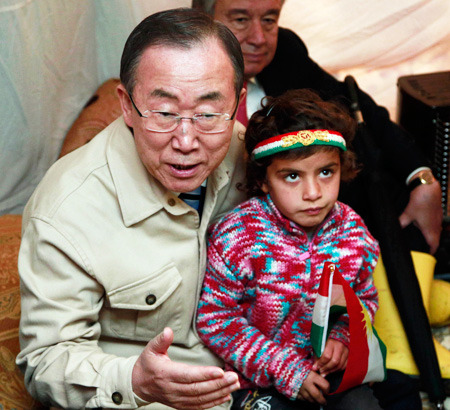 (AP-Yonhap) U.N. Secretary-General Ban Ki-moon sits inside a tent belonging to a Syrian family at a refugee camp in Irbil, 350 kilometers north of Baghdad, Iraq, Tuesday. Ban expressed his deep sadness over the suffering and the hard conditions the refugees are living in. The Syrian conflict, which began in March 2011, has killed more than 120,000 people, forced more than 2 million to flee the country and devastated the nation's cities, economy and social fabric.