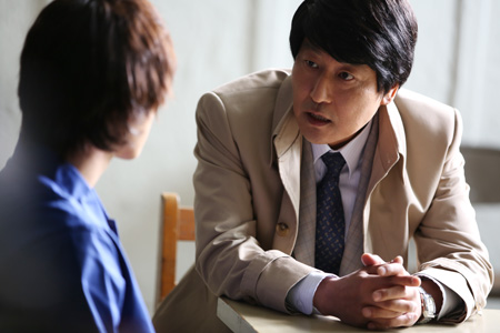 "Song Kang-ho, right, in a scene from ""The Attorney"""