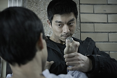 "Gong Yoo in a scene from ""The Suspect"""