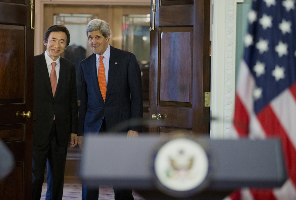 Secretary of State John Kerry, right, and South Korean Foreign Minister Yun Byung-se arrive to deliver statements after a meeting at the State Department in Washington, Tuesday, Jan. 7, 2014. (AP Photo/ Evan Vucci)