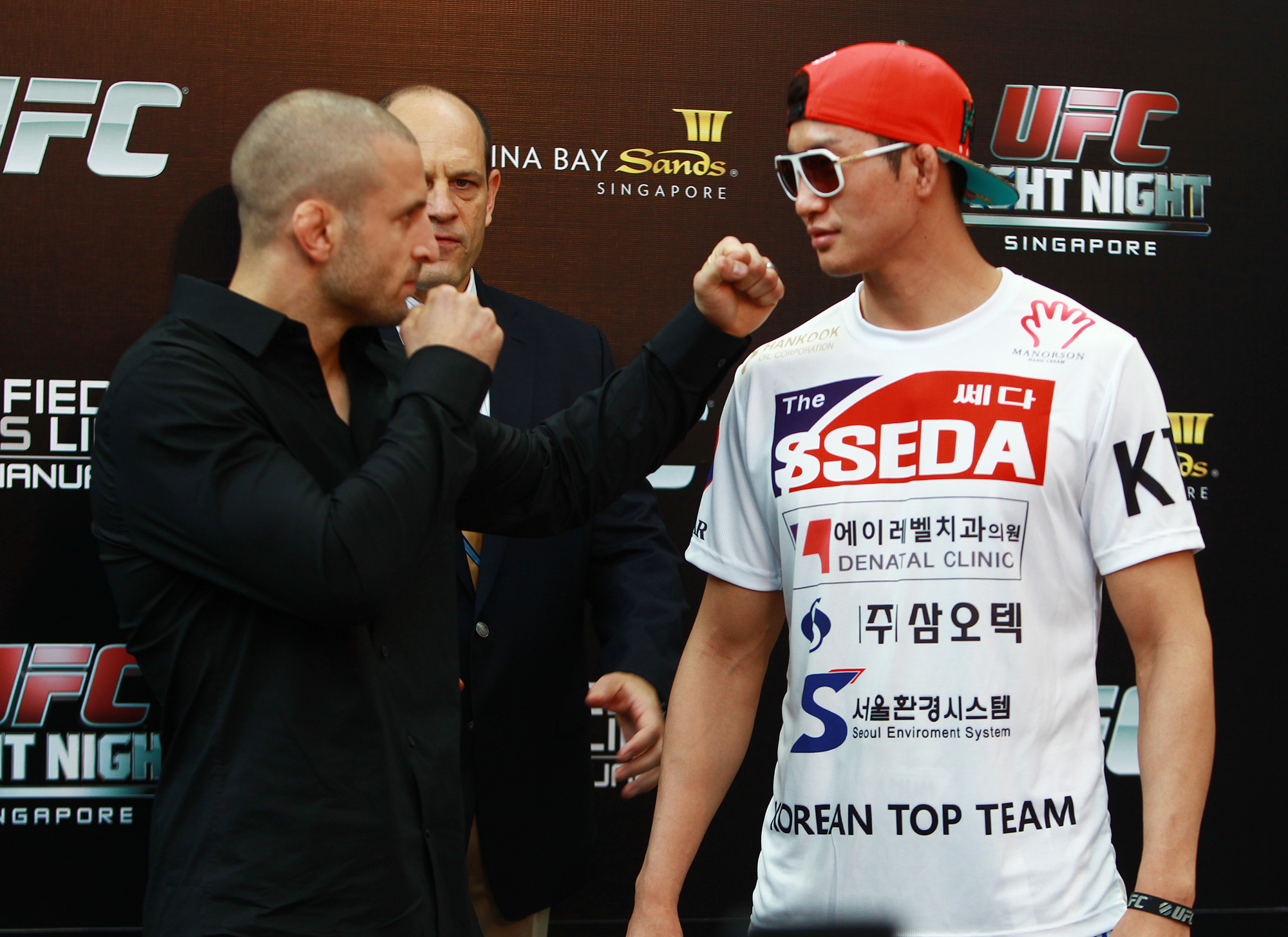 Lim, right, and Saffiedine posed for media on Friday. Lim could make race car drivers jealous. (UFC/Yonhap)