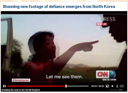 A North Korean woman, an owner of private bus service, standing up to a government soldier who tried to shut down her business on grounds that it's illegal. (Courtesy of CNN)