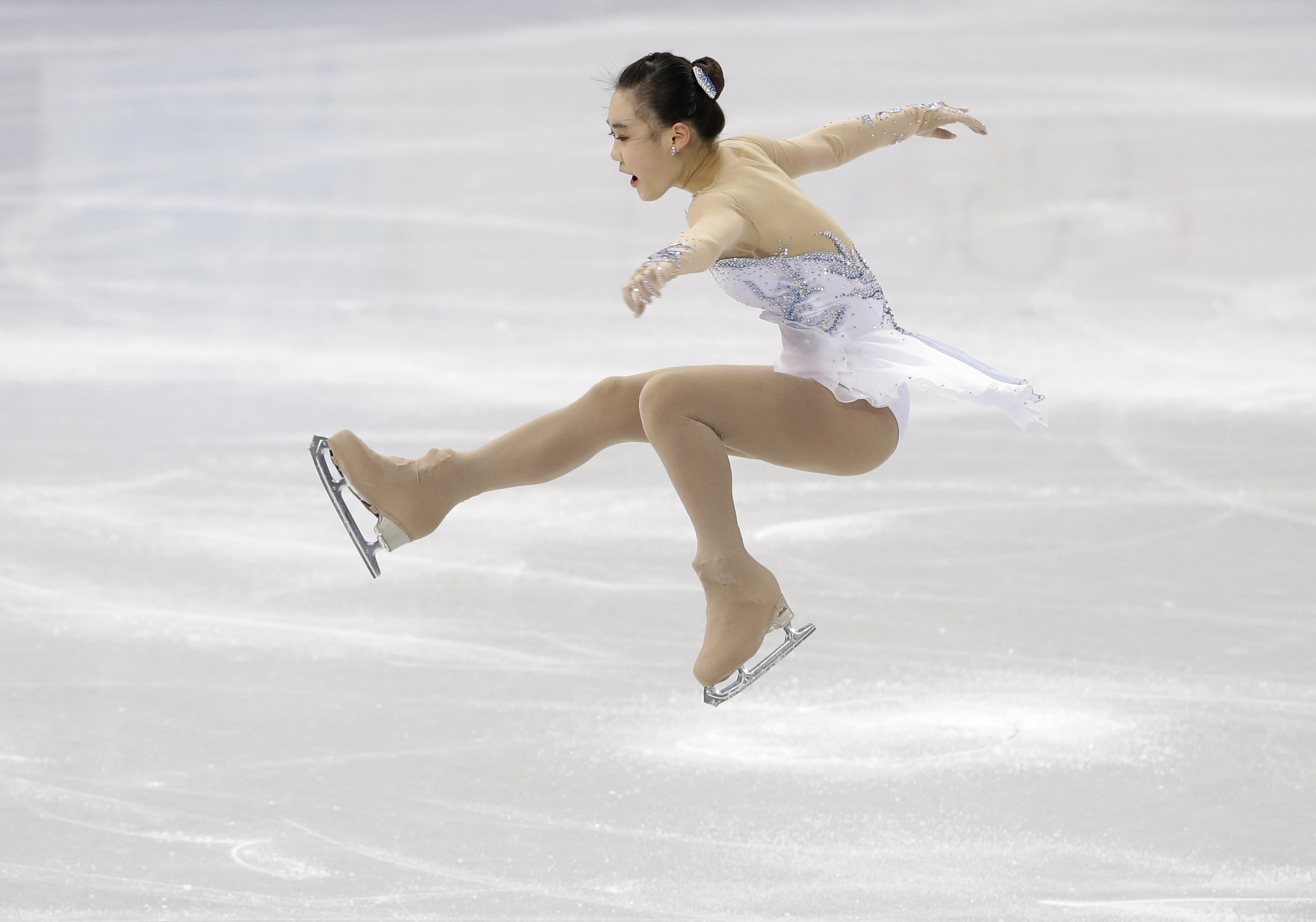 Park So-Youn of South Korea competes in the women's short program figure skating competition at the Iceberg Skating Palace during the 2014 Winter Olympics, Wednesday, Feb. 19, 2014, in Sochi, Russia. (AP Photo/Darron Cummings)