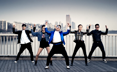 "Lee Ju-sun, far left, dances with Psy in this photo captured from the singer's ""Gentleman"" music video. The creator of the ""Gangnam Style"" horse-riding dance said many choreographers in Korea are wrestling economic trouble."