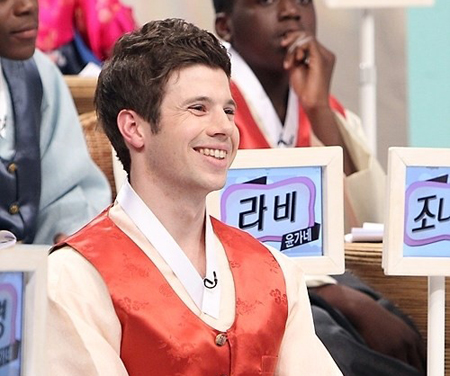 "San Jose-native Kris Johnson smiles during his appearance on an MBC variety show program ""Three Wheels"" in this captured screen image. Johnson is slowly making his name known in Korea."