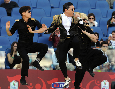 "Lee Ju-sun, left, dances to ""Gangnam Style"" with Psy during intermission at the TIM Cup final match between AS Roma Vs. SS Lazio at Stadio Olimpico soccer arena in Rome, Italy, in this May 26, 2013 file photo."