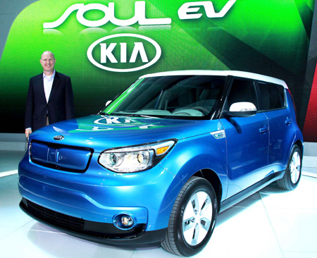 Orth Hedrick, vice president of product planning at Kia Motors America, poses next to the automaker's Soul EV at the Chicago Auto Show, Friday. (Courtesy of Kia Motors)