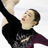 Russia's Yulia Lipnitskaya, top, has emerged as the biggest threat to Korean figure-skating megastar Kim Yu-na, who is looking to become only the third woman ever to repeat as Olympic champion. (AP-Yonhap, Korea Times)