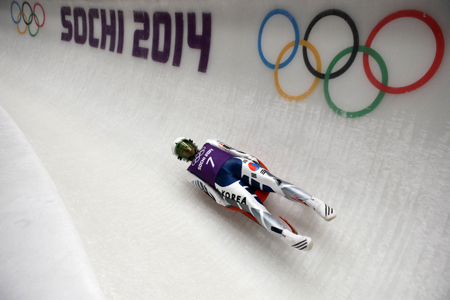 Korea's Sung Eun-ryung races down the track at the women's luge training session at the Sanki Sliding Centre.