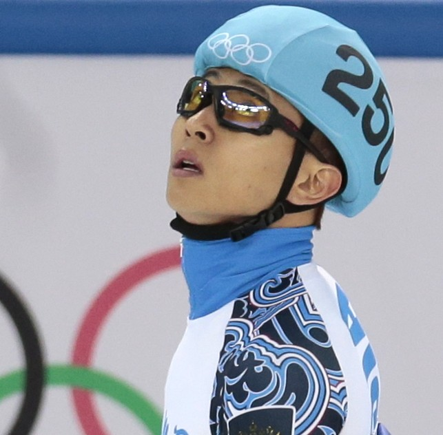 Viktor Ahn of Russia celebrates placing third in the men's 1500m short track speedskating final at the Iceberg Skating Palace during the 2014 Winter Olympics, Monday, Feb. 10, 2014, in Sochi, Russia. (AP Photo/Ivan Sekretarev)