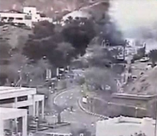 An image made from a video provided by the Israeli Airports Authority shows smoke, white area at upper right,. from the bombing of the bus carrying South Korean sightseers near the tip of the Red Sea's Gulf of Aqaba Sunday Feb. 16, 2014.  At least three South Korean tourists were killed and 12 seriously wounded, according to Egyptian security officials.   (AP Photo/Israeli Airports Authority)