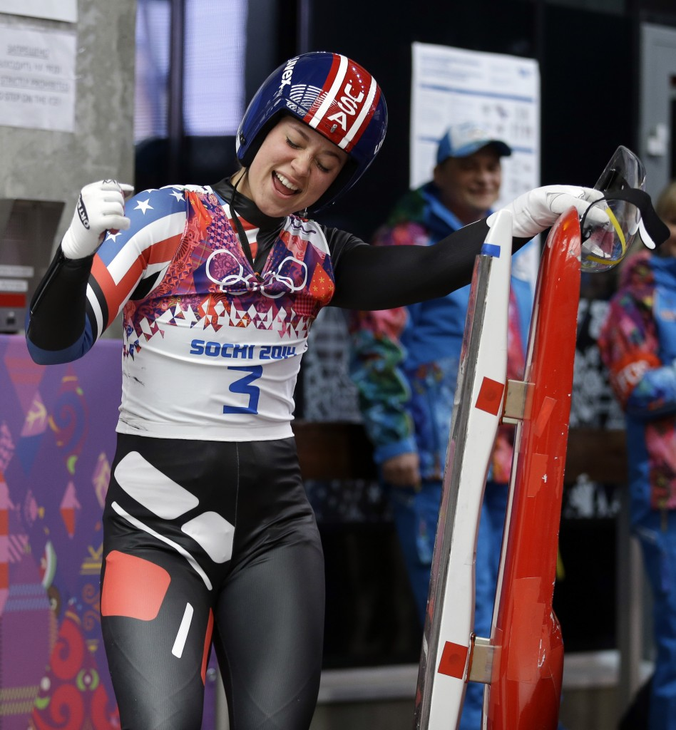 Kate Hansen of La Canada reacts after her final run during the women's singles luge competition at the 2014 Winter Olympics, Feb. 11, 2014, in Krasnaya Polyana, Russia. (AP Photo/Natacha Pisarenko)