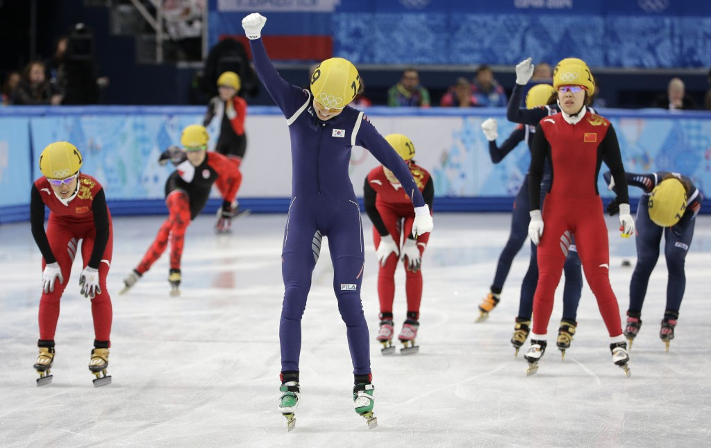 Shim Suk-Hee of South Korea, centre, celebrates her team's first place in the women's 3000m short track speedskating relay final at the Iceberg Skating Palace during the 2014 Winter Olympics, Tuesday, Feb. 18, 2014, in Sochi, Russia. (AP Photo/David J. Phillip )