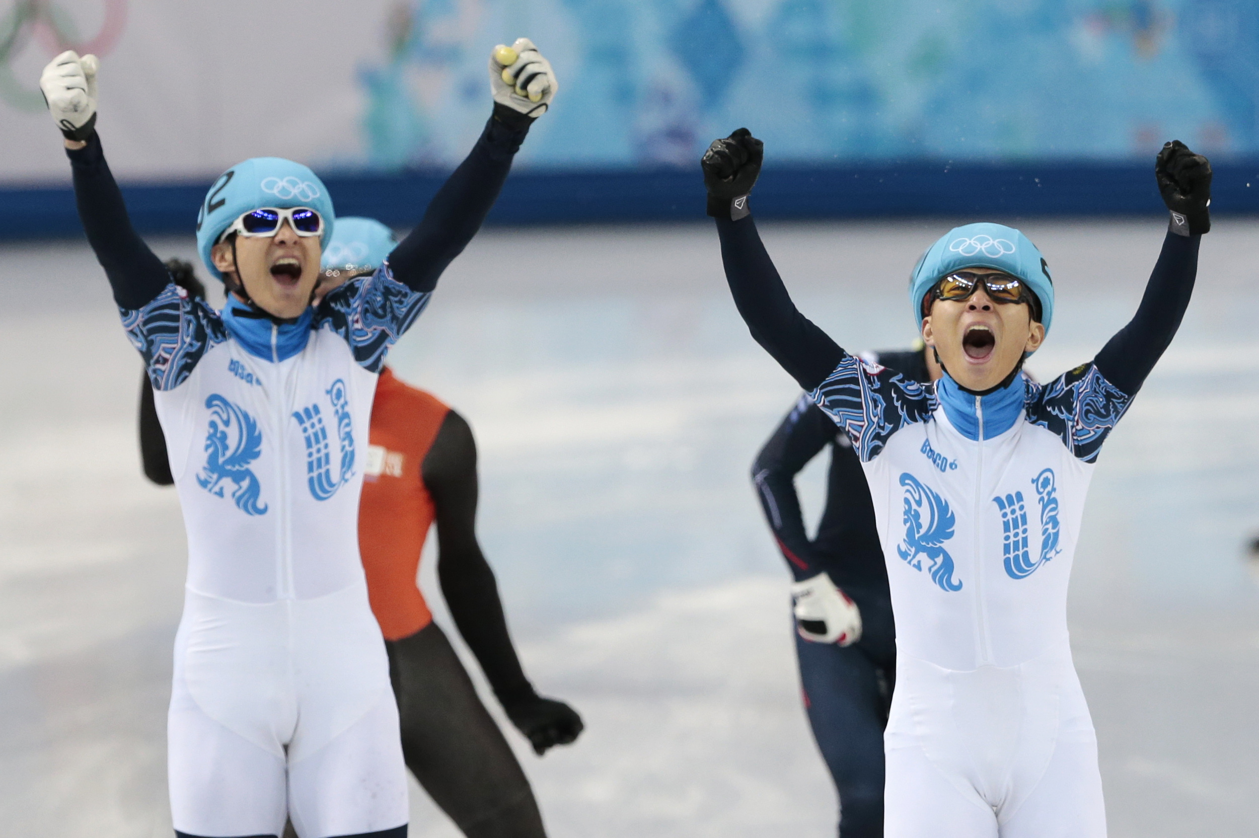 Viktor Ahn of Russia, right, celebrates winning in a men's 1000m short track speedskating final with second placed Vladimir Grigorev of Russia, left, at the Iceberg Skating Palace during the 2014 Winter Olympics, Saturday, Feb. 15, 2014, in Sochi, Russia. (AP Photo/Ivan Sekretarev)
