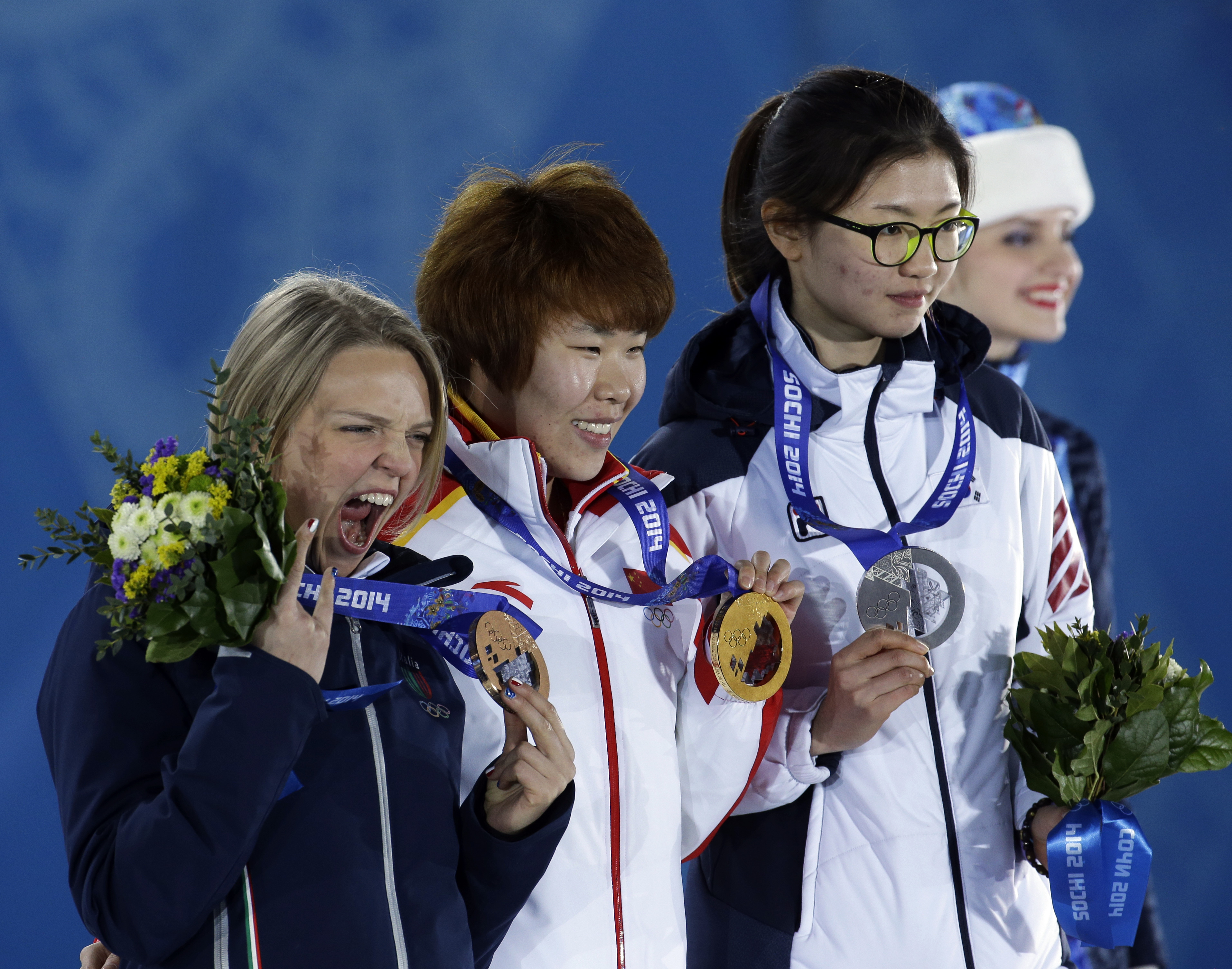 Women's 1,500-meter short track speedskating medalists, from left, Italy's Arianna Fontana, bronze, China's Zhou Yang, gold, and South Korea's Shim Suk-hee, silver, pose with their medals at the 2014 Winter Olympics in Sochi, Russia, Saturday, Feb. 15, 2014.  (AP Photo/Morry Gash)