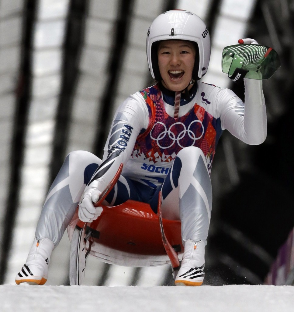 Sung Eunryung of S. Korea cheers after her final run during the women's singles luge competition at the 2014 Winter Olympics, Tuesday, Feb. 11, 2014, in Krasnaya Polyana, Russia. (AP Photo/Dita Alangkara)