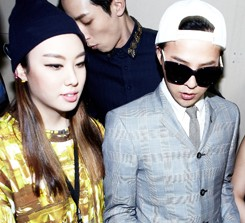 Kathleen Kye, left, enters a showroom with her long time patrons G-Dragon and Ciel at her 2013 Fall/Winter collection, at the Seoul Fashion Week, held in March 2013. (Courtesy of Kathleen Kye)